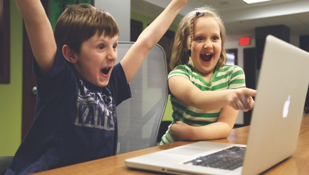 Happy Children in front of computer